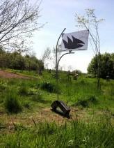 Henk Maassen - 02)-Dancing on the Top of the Wind-2009-RVSmetaal gebrand op bruinglas-85x60x10 cm.-€2.900_593x768
